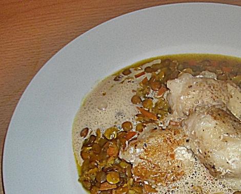 Steinbeisserbäckchen auf Currylinsen mit Langpfefferschaum